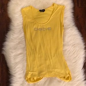 The bebe yellow top